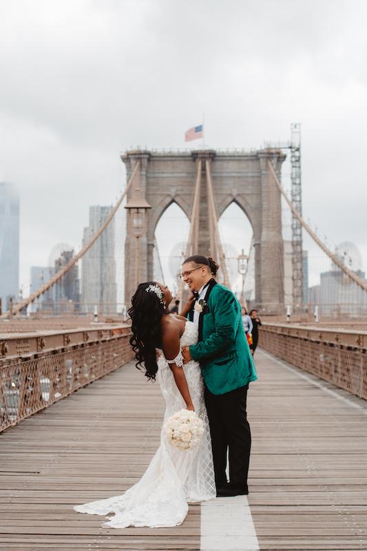 bride and groom on bridge at wedding in new york city
