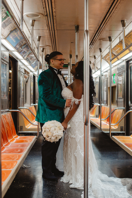 bride and groom on the subway at their september wedding in new york city