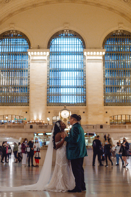 bride and groom dancing in grand central station