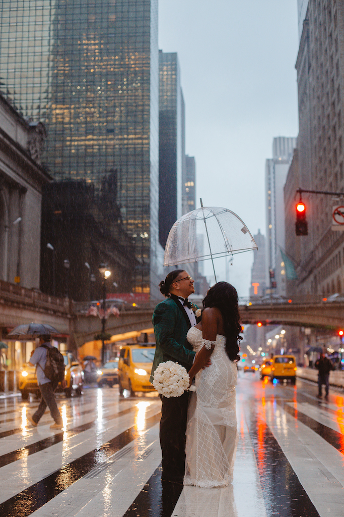 bride and groom in the rain